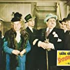 Oliver Hardy, James Bush, Anthony Caruso, Douglas Fowley, Stan Laurel, and Noel Madison in Jitterbugs (1943)