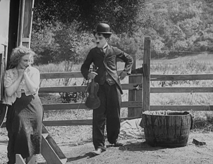fc881ef29c7 Charles Chaplin and Edna Purviance in The Vagabond (1916)