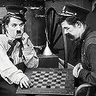 Charles Chaplin and Albert Austin in The Fireman (1916)