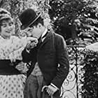 Charles Chaplin and Mabel Normand in Caught in a Cabaret (1914)