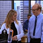Rebecca Romijn and Brian Posehn in Just Shoot Me! (1997)