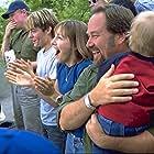 Richard Karn, Cynthia Stevenson, Kevin Zegers, Emma Marof, and Hannah Marof in Air Bud: Seventh Inning Fetch (2002)