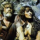 Dana Gillespie and Doug McClure in The People That Time Forgot (1977)