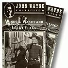 John Wayne, Barbara Sheldon, and Lloyd Whitlock in The Lucky Texan (1934)