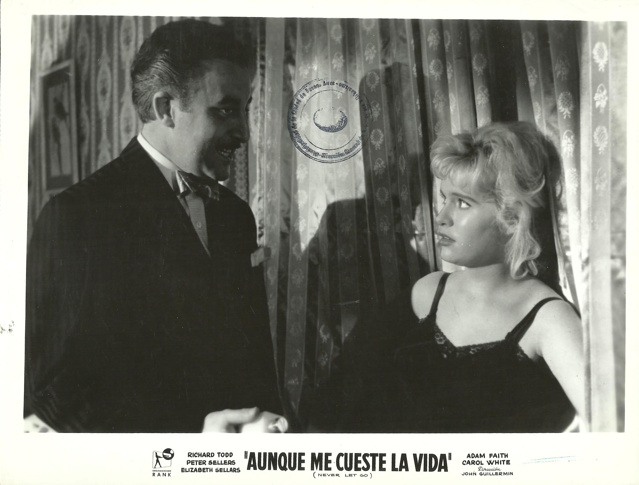 Peter Sellers and Carol White in Never Let Go (1960)