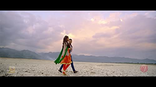 """The movie is centered around a young couple, Joy (Bonny Sengupta) and Diya (Koushani Mukherjee) who fall in love with each other. It's basically a story of two young hearts whose unconditional love for each other make them fight against all barriers. This Valentine's Day, re-discover love like never before with """"Tomake Chai"""",a saga of never-ending struggles of two relentless love-struck souls."""