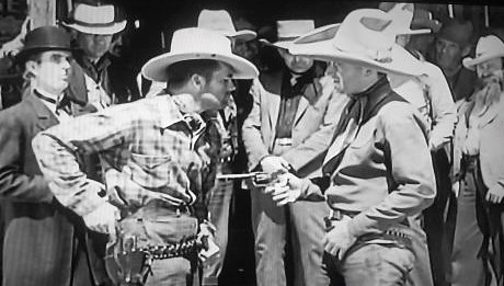 John Wayne, Chris Allen, Chuck Baldra, Barney Beasley, Herman Hack, Reed Howes, and Nelson McDowell in The Dawn Rider (1935)