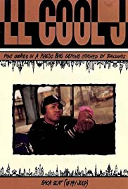 LL Cool J: Pink Cookies in a Plastic Bag Getting Crushed by Buildings Poster