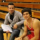 Director Alex Ranarivelo and actor George Kosturos on the set of American Wrestler: The Wizard.