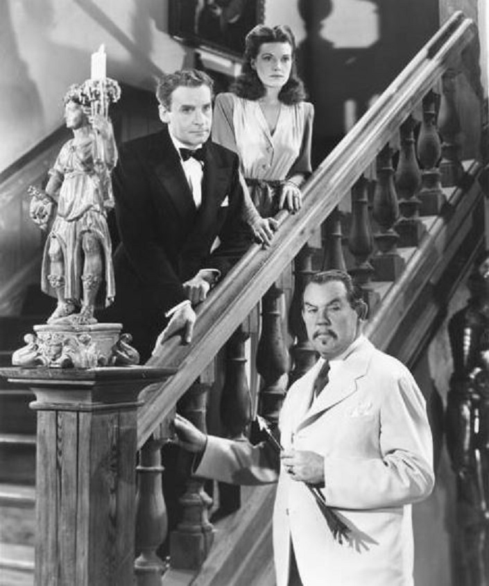 Henry Daniell, Sidney Toler, and Arleen Whelan in Castle in the Desert (1942)
