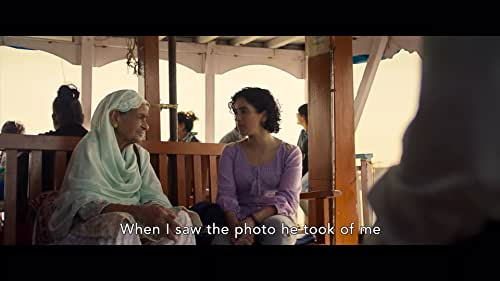A struggling street photographer in Mumbai, pressured to marry by his grandmother, convinces a shy stranger to pose as his fiancée. The pair develop a connection that transforms them in ways they could not expect.