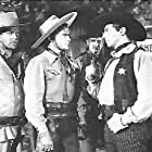 Don 'Red' Barry, Bob Burns, Hal Taliaferro, and Carleton Young in Adventures of Red Ryder (1940)