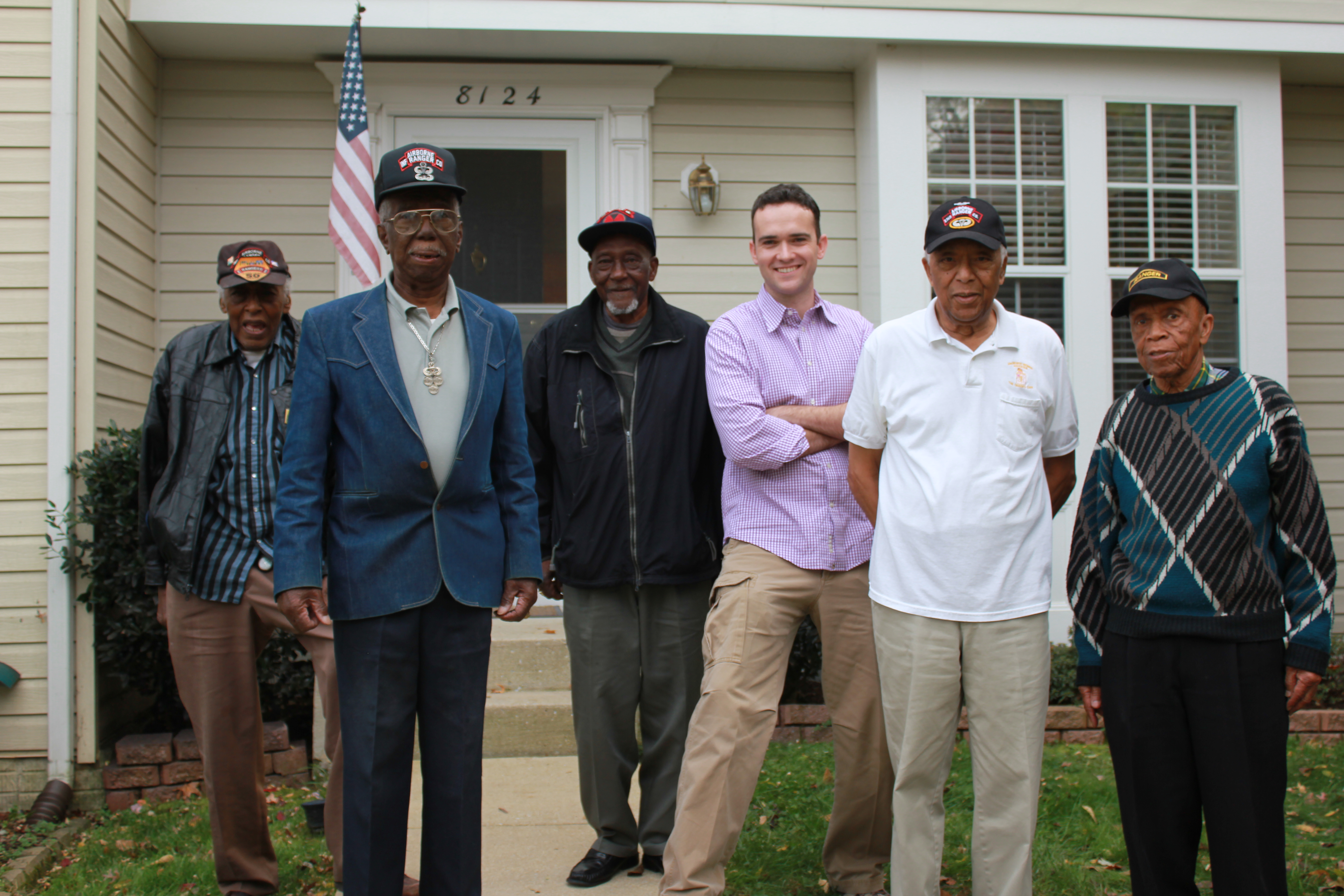 """Still from """"Finnigan's War"""" (2013).  Conor posing with members of the Korean War's all-black 2nd Rangers."""