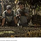 Dylan O'Brien and Ki Hong Lee in The Maze Runner (2014)