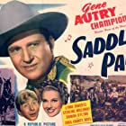 Gene Autry, Sterling Holloway, The Cass County Boys, Lynne Roberts, and Champion Jr. in Saddle Pals (1947)