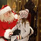 Richard Riehle and Kaitlyn Maher in The Search for Santa Paws (2010)