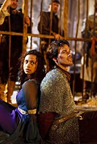 Angel Coulby and Santiago Cabrera in Merlin (2008)
