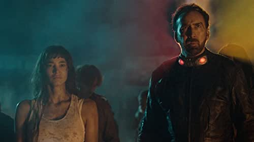 In the treacherous frontier city of Samurai Town, a ruthless bank robber (Nicolas Cage) is sprung from jail by wealthy warlord The Governor (Bill Moseley), whose adopted granddaughter Bernice (Sofia Boutella) has gone missing. The Governor offers the prisoner his freedom in exchange for retrieving the runaway. Strapped into a leather suit that will self-destruct within five days, the bandit sets off on a journey to find the young woman -- and his own path to redemption.