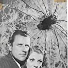 Warren Hull and Iris Meredith in The Spider's Web (1938)