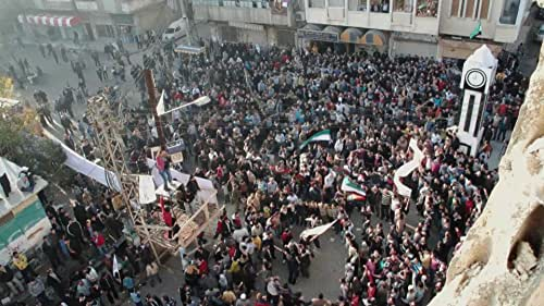 A look behind the barricades of the besieged city of Homs, where for nineteen-year-old Basset and his ragtag group of comrades, the audacious hope of revolution is crumbling like the buildings around them.