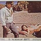Alain Delon and Irina Demick in Le clan des Siciliens (1969)