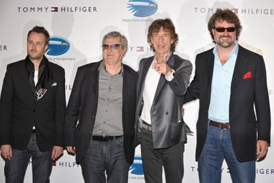 Director Stephen Kijak (L) singer Mick Jagger of the Rolling Stones (second right) and guests attend the 'Stones in Exile' Photo Call held at the Salon Martha Barriere at the Hotel Majestic during the 63rd Annual International Cannes Film Festival on May 19, 2010 in Cannes, France.
