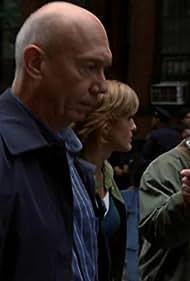 Mariska Hargitay, Dann Florek, and Bruce Kirkpatrick in Law & Order: Special Victims Unit (1999)