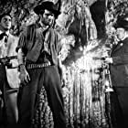 Edgar Buchanan, Macdonald Carey, and Hugh O'Brian in Cave of Outlaws (1951)