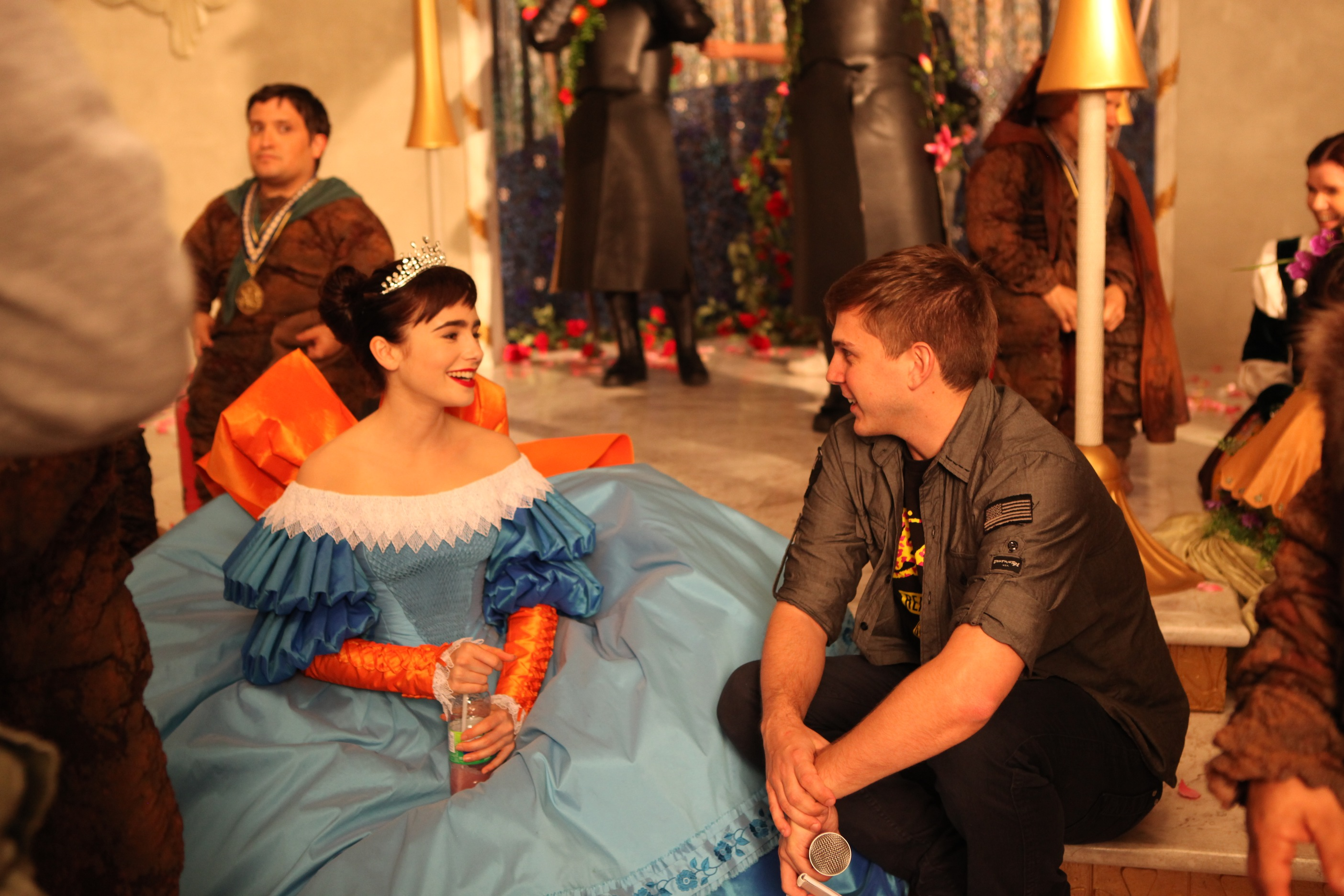 """Choreographer Paul Becker and Lily Collins on set of """"Mirror Mirror""""."""