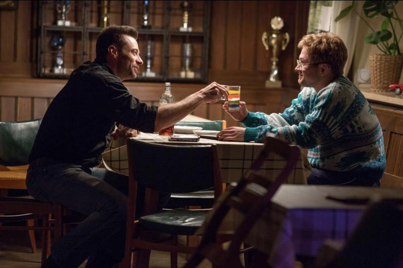 Hugh Jackman and Taron Egerton in Eddie the Eagle (2015)