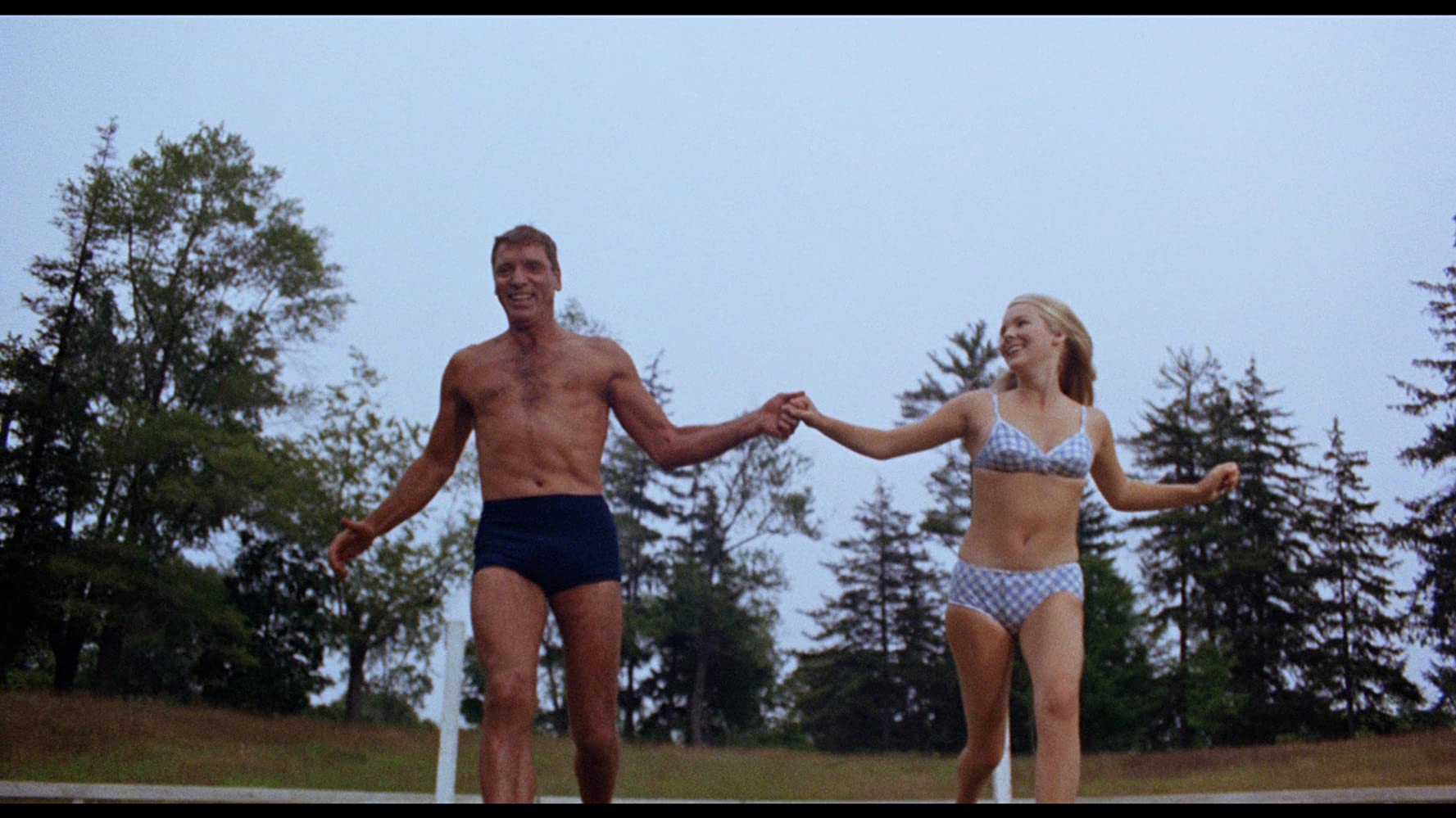 Burt Lancaster and Janet Landgard in The Swimmer (1968)