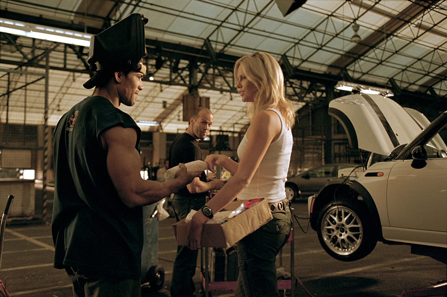 Charlize Theron, Jason Statham, and Franky G in The Italian Job (2003)