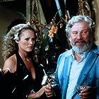 Ursula Andress and Peter Ustinov in Doppio delitto (1977)