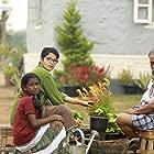 Nedumudi Venu and Aparna Gopinath in Charlie (2015)