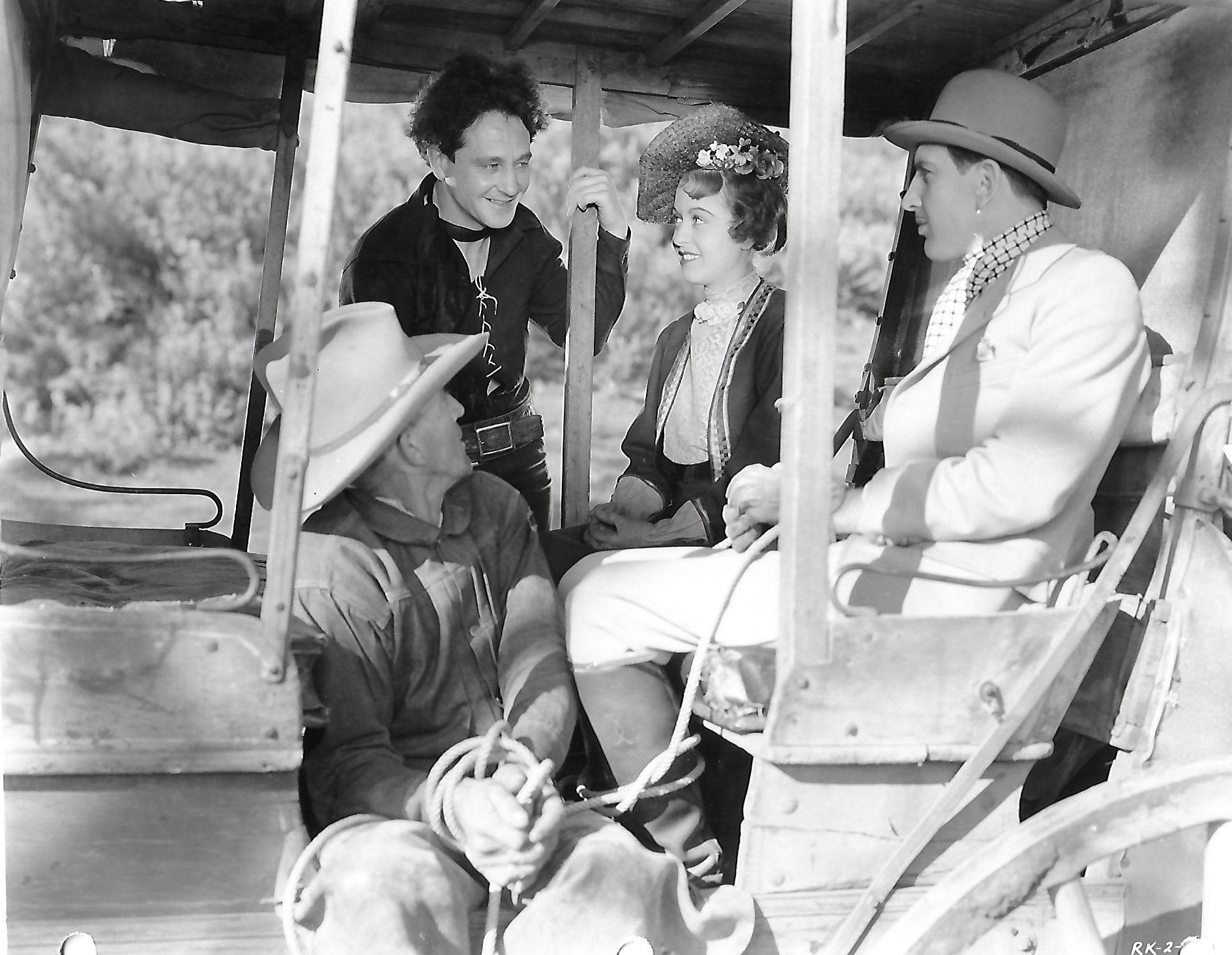Marie Burton, Bill Cody, Allen Greer, and Stuart James in The Texas Rambler (1935)