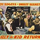 Roy Rogers, Smiley Burnette, Lynne Roberts, and Edwin Stanley in Billy the Kid Returns (1938)