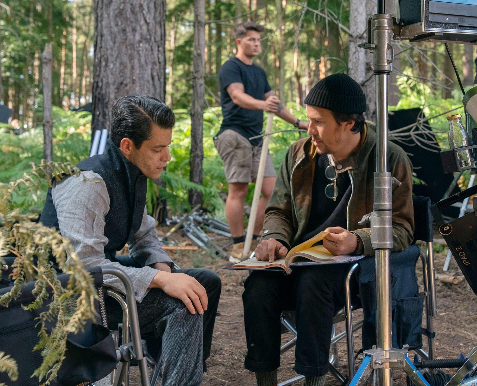 Cary Joji Fukunaga and Rami Malek in No Time to Die (2021)
