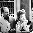Stuart Holmes and Juanita Stark in Crime by Night (1944)