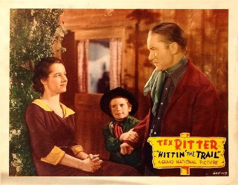 Jerry Bergh, Tommy Bupp, and Tex Ritter in Hittin' the Trail (1937)