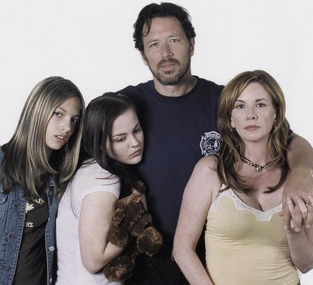 """CiCi Hedgpeth, Azure Dawn, Brian Wimmer, and Melissa Gilbert in a still for """"Heart of the Storm""""."""