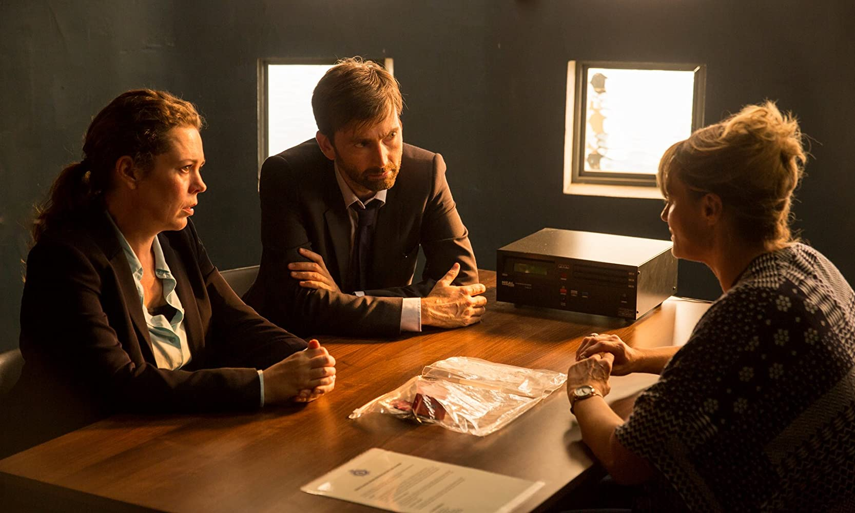 Sarah Parish, David Tennant, and Olivia Colman in Broadchurch (2013)
