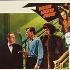 Lucille Bremer, Richard Carlson, and Herbert Heyes in Behind Locked Doors (1948)