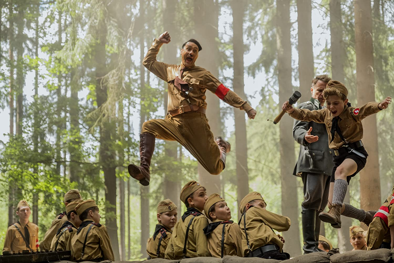 Sam Rockwell, Taika Waititi, and Roman Griffin Davis in Jojo Rabbit (2019)