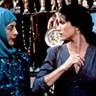 Andie MacDowell and Lydia Lenosi in Ruby Cairo (1992)