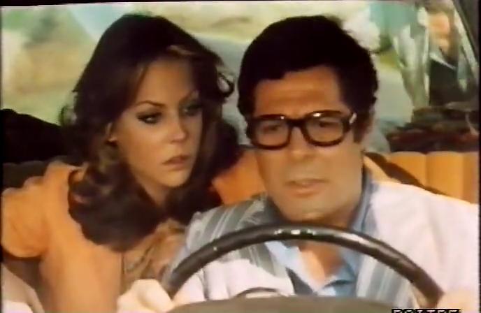 Marcello Mastroianni and Carole André in Mordi e fuggi (1973)
