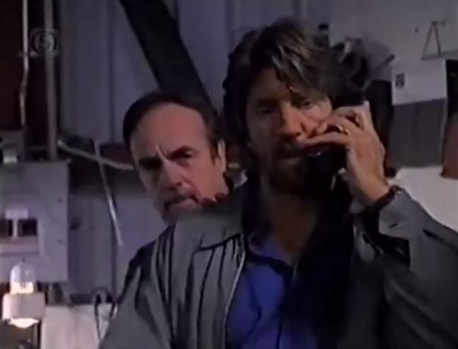 Eric Roberts and Gene Butler in C-16: FBI (1997)