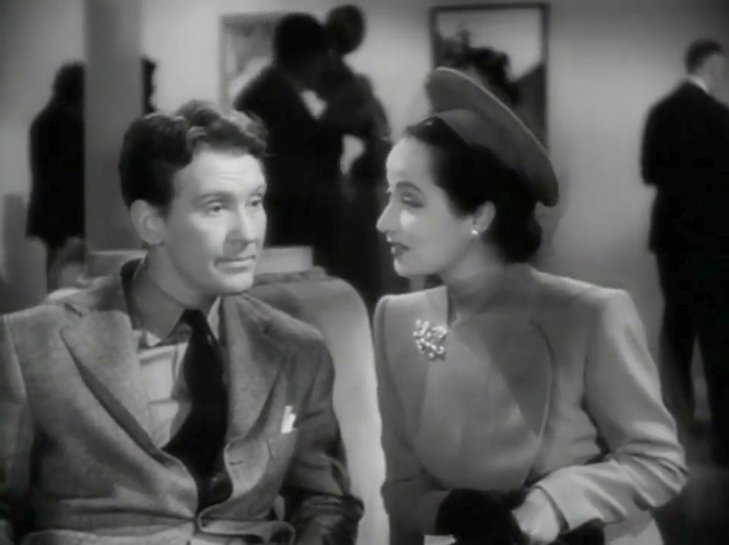 Burgess Meredith and Merle Oberon in That Uncertain Feeling (1941)