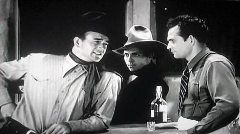 John Wayne, Yakima Canutt, and Dennis Moore in The Dawn Rider (1935)