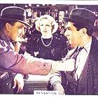 John Lodge and Margaret Vyner in Sensation (1936)