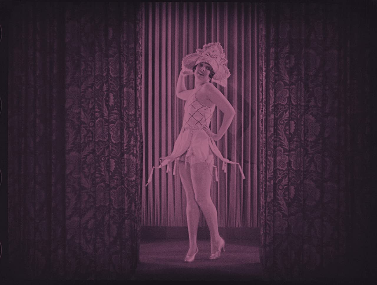 Carmelita Geraghty in The Pleasure Garden (1925)